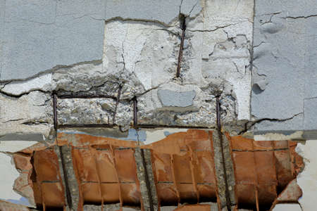 ruined balcony that is about to collapse with visible construction steel and bricks Banco de Imagens