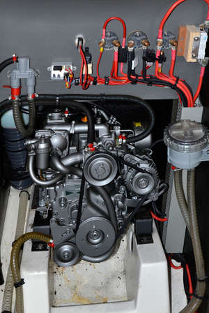 engine of a sailboat with cables, strap, cooling Editorial