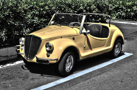 yellow car with the classic Italian design of the 1960s