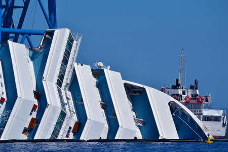 recuperation: demolition of a cruise ship sunk off the island of Giglio, Italy Stock Photo
