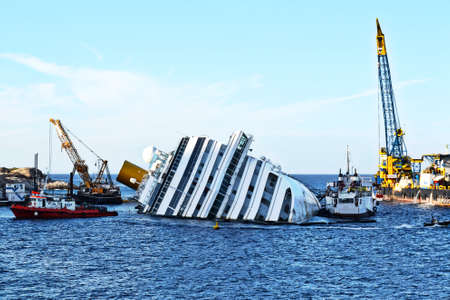 demolition of a cruise ship sunk off the island of Giglio, Italy Фото со стока