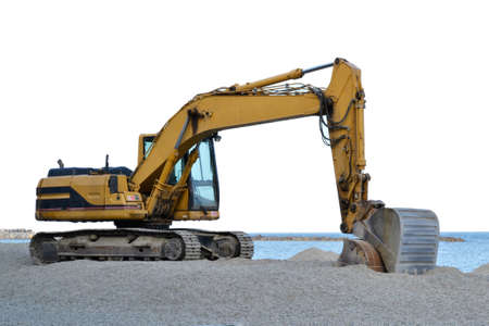 excavator that is working on the beach to smooth the sand before the start of the summer season Stock Photo