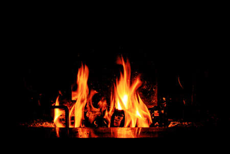 flames lit in a wood burning fire to warm up on a cold winter evening Banco de Imagens