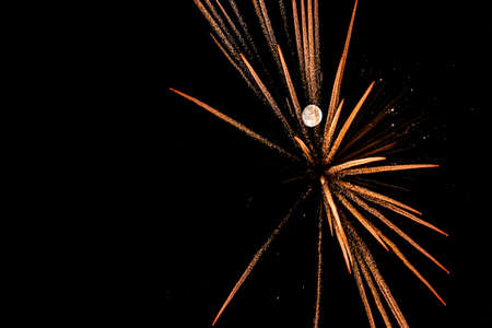 spectacular New Years Eve with fireworks and full moon to celebrate the arrival of the New Year