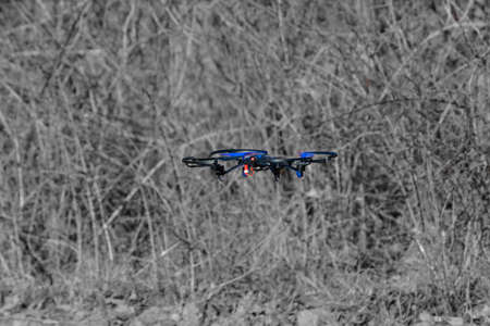 remote aerial quadcopter drone, with hight resolution camera, flying in the countryside, which makes a survey of the territory, Italy Stock Photo