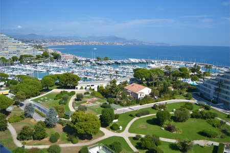 sea view of the park and the marina of the residential center of Marina Baie Des Anges, Villeneuve Loubet, Gulf of Nice, Cote d'Azur, France Banque d'images - 96000141