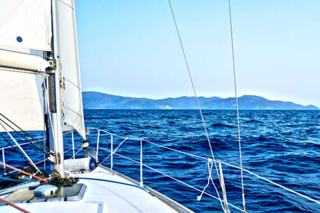 fun and relaxing sailing boat tour with the wind in the hair between the waves of the Mediterranean Sea, Italy Banque d'images - 96000145