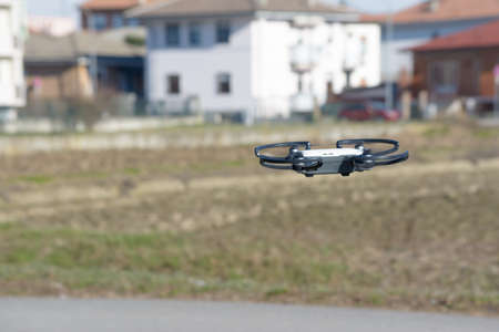 drone in flight close to a town, which makes photographs with a high resolution camera, Italy Banque d'images - 96000168