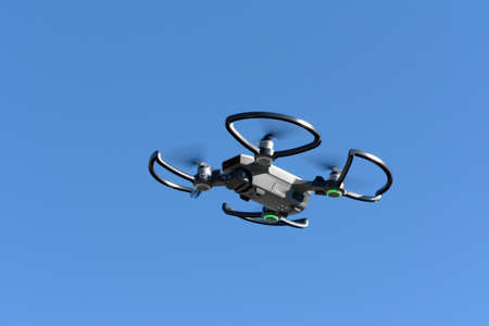 quadcopter drone flying in the blue sky, which makes photographs and video footage of the territory, Italy Banque d'images - 96000169