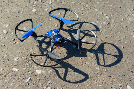 remote aerial quadcopter drone landing, with hight resolution camera, flying in the countryside, which makes a survey of the territory, Italy