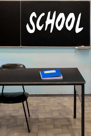 school classroom with a blackboard hanging on the wall and the register of votes on the desk Banque d'images