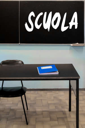 school classroom with a blackboard hanging on the wall. Translation: Banque d'images - 99396419