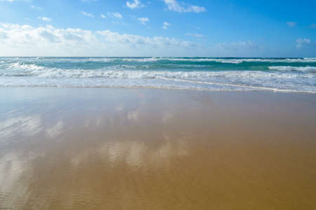 gorgeous white sand beach of Cofete beach, crystal clear sea, ocean waves, Fuerteventura, Canary Islands, Spain