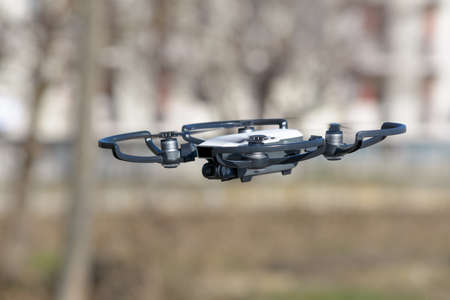 remote aerial quadcopter drone, with hight resolution camera, flying in the countryside, which makes a survey of the territory, Italy Banque d'images