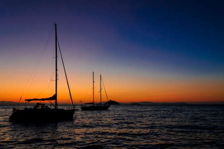 relaxing and silent sunrise on the sea, on a sailboat