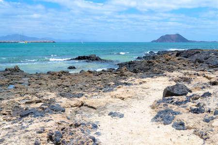 white beach with black volcanic rocks, by the sea, Corralejo, Fuerteventura, Canary Islands, Spain