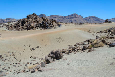 white desert sand and volcanic rocks at high altitude on Mount Teide, Tenerife, Canary Islands, Spain