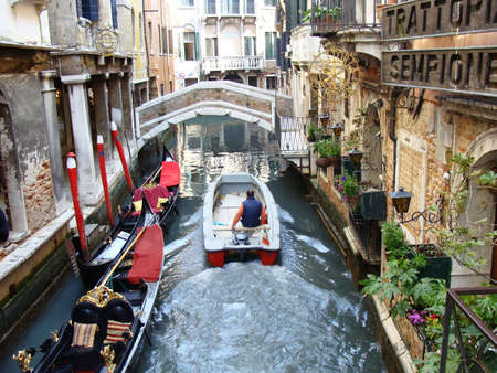 Venice Italy, April 23, 2010, motor boats compete with traditional boats in crowded canals