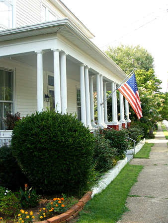 front porch: Front porch with an American flag