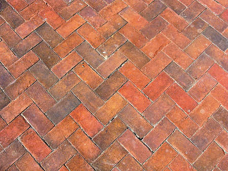 Background of traditional bricks in a herringbone pattern photo