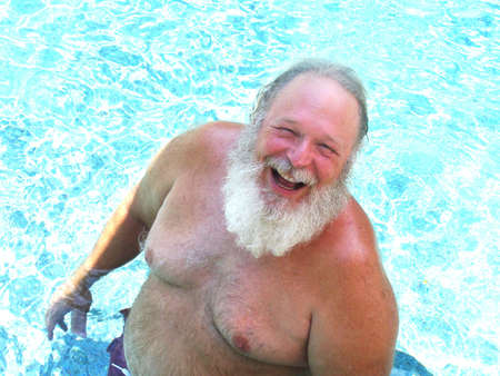 A Robust Elderly Man in a Swimming Pool photo