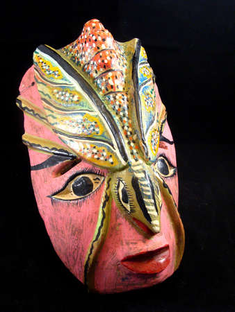 A Carved Wooden Mask from Mexico photo