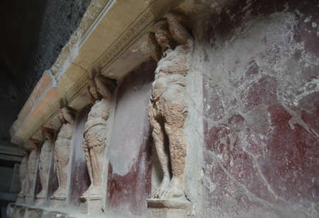 cultural artifacts: Statues Along a Wall in Pompeii Italy