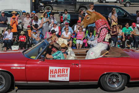 calgary stampede: the mascot harry the horse sitting in red cabriolet at calgary stampede parade Editorial