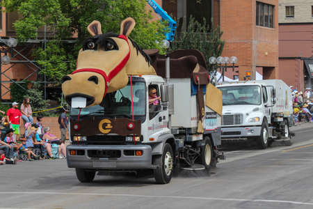 calgary stampede: street sweeper costumed up like a horse at calgary stampede parade