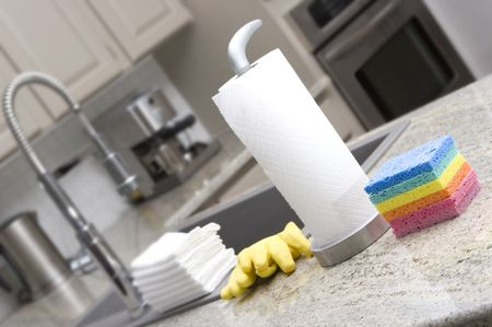 sponges, paper towels, gloves, cloths in modern kitchen for housework Stock Photo