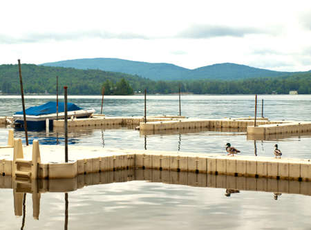 docks on a scenic lake in the adirondack mountains in new york state