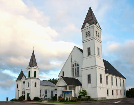 two white churches in a small town