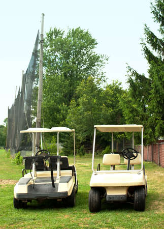 two golf carts parked