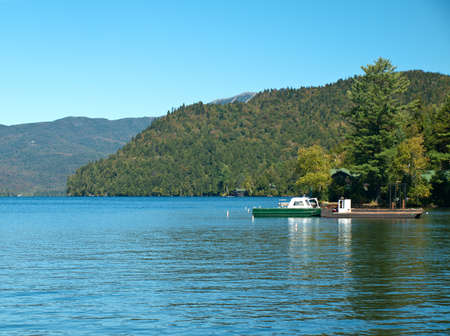 view of lake placid, new york on beautiful early autumn day