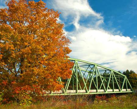 iron bridge in autumn scene