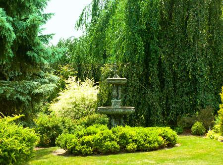 lush garden and fountain statue