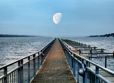 boat dock and moon at dusk
