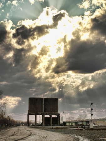urban railyard with clouds and sunrays photo