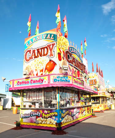 cotton candy: candy and popcorn stand on a carnival midway
