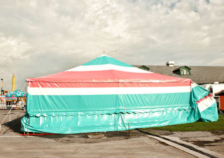 circus tent style covering for vendors and games of chance booths at a fair Stock Photo