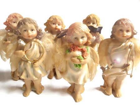 group of angel figurines on white background Stock Photo