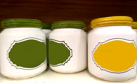 jars with lids and blank lables on a shelf