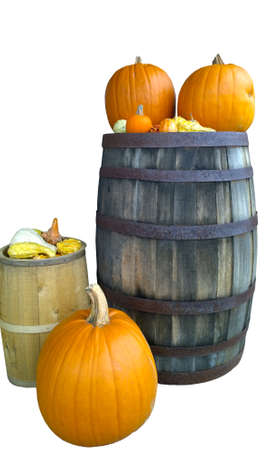 autumn pumpkins and gourds on barrels isolated on white Stock Photo