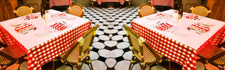 checker plate: tables in a restaurant with checkered tablecloths