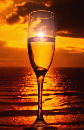 champagne flute: champagne flute and tropical sunset Stock Photo