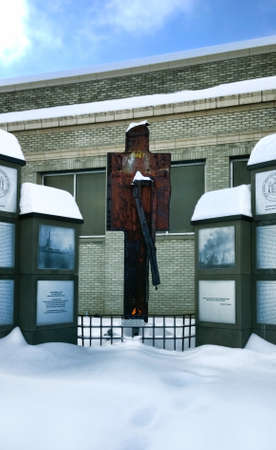 lakeland: Syracuse, New York, USA, January 7,2015. 911 Memorial located on the New York State Fairgrounds in Lakeland, New York. Eternal flame and steel from the Trade Tower ruins
