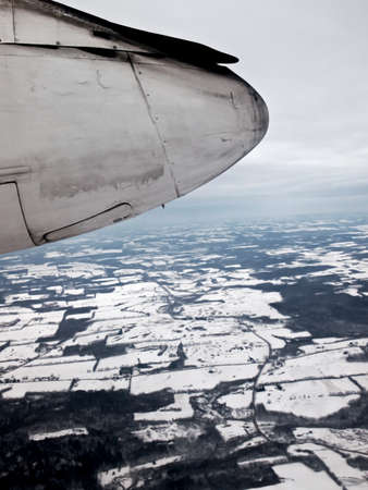 bombardier: view of the landing gear and wheel well of a Bombardier aircraft over winter landscape Stock Photo