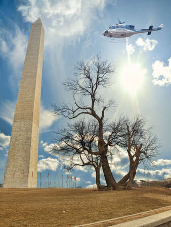 The Washington Monument and Mulberry tree with U.S. Park Police helicopter flying over Stock Photo
