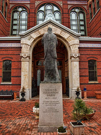Washington, DC, USA. March 10,2015 . Statue of Spencer Fullerton Baird, second secretary of the Smithsonian Institution, near  the garden of the Smithsonian Museum Castle