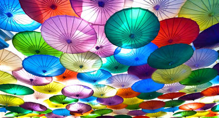 colorful decorative umbrellas hanging from a ceiling Stock Photo